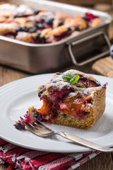 Yeast cake with plums and blueberries.