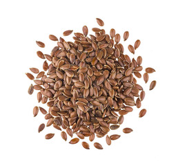 Stores photo Graine, aromate Pile of flax seeds isolated on white background close-up, top view