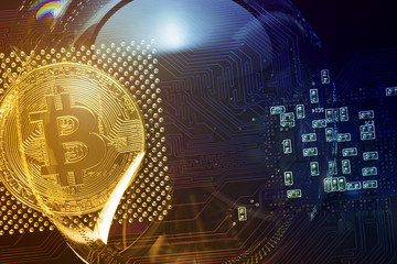 Bitcoin. Bitcoin in a soap bubble on the video card background.