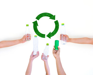 Hand hold show Recyclable plastic bottle a White background and paper cutter