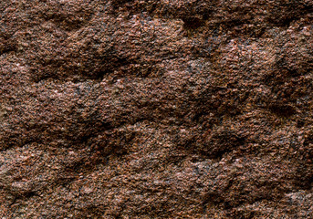dark brown stone uneven weathered natural background wall part grunge texture