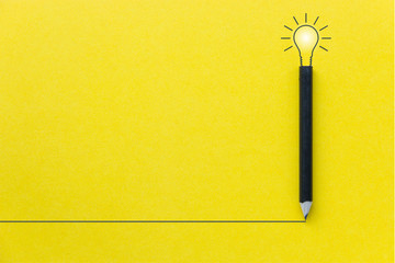 Black pencil on yellow backgroud with light bulb illustration line and copyspace for Inspiration and Creative concept