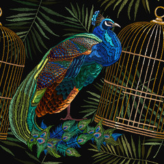 Embroidery peacocks and birds gold cage seamless pattern. Classical fashionable embroidery beautiful peacocks. Fashionable template for design of clothes. Tails of peacocks and birds cage