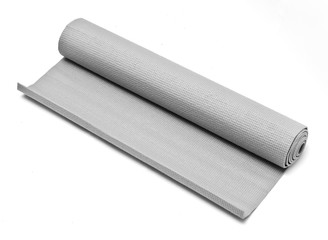 A grey rolled up fitness mat on white background.