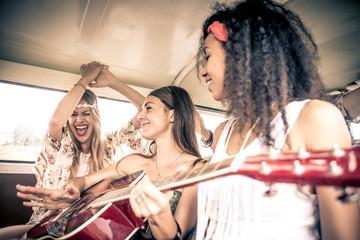 Hippie friends driving on a minivan