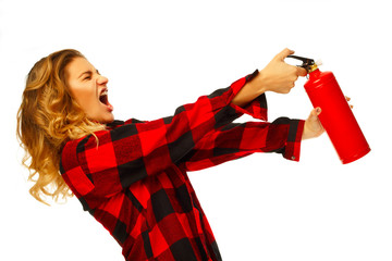 Young funny beautiful woman holding fire extinguisher over white background
