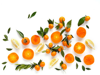 Fototapete - Creative flat layout of fruit, top view. Sliced orange, lemon, persimmon, tangerine, green leaves isolated on white background. Food wallpaper, composition pattern of fresh fruits.