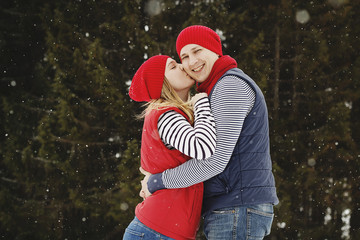 Young happy couple outdoors in winter park