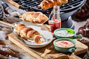 Freshly barbecued skewers of crusty twist bread