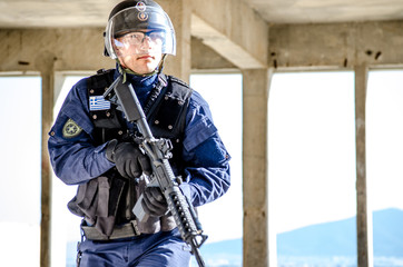 Police special forces, blue uniform and protection helmet