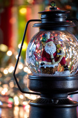 Santa snowglobe with bokeh background