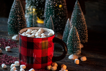 hot cocoa with marshmallows in festive setting closeup