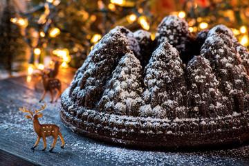 Tree mold chocolate cake with powdered sugar snow