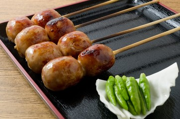 Thai Grilled Sausages on A Black Tray