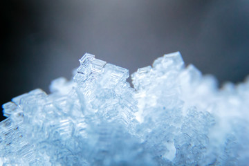 Macro shot of ice crystals. Natural snowflakes on snow. Rime