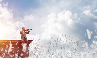 Handsome businessman play his melody and symbols fly around in air