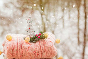 Decor christmas tree on pink sweaters on winter nature background