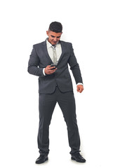 A handsome businessman in an elegant suit with a mobile phone in his hand.