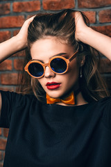 girl in round sunglasses