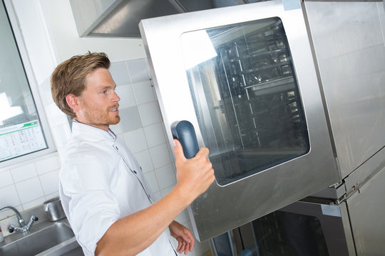 man opening the big oven