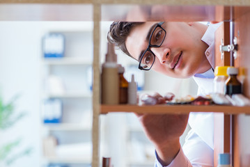Doctor at farmacy retail shop looking for medicines