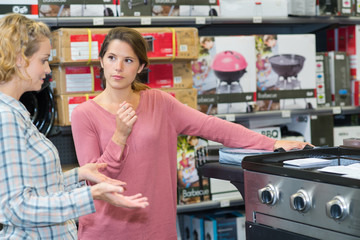 Woman looking at range cooker in store