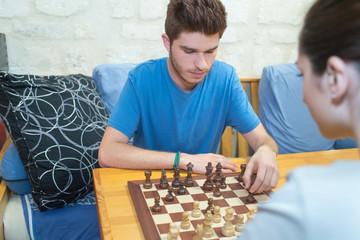 happy couple enjoys playing chesscouple playing chess