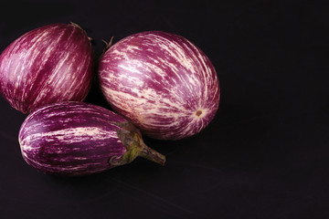 three striped ripe eggplants