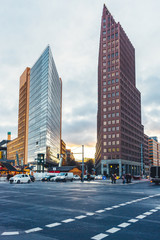 potsdamer platz at berlin with street and blurred cars and people