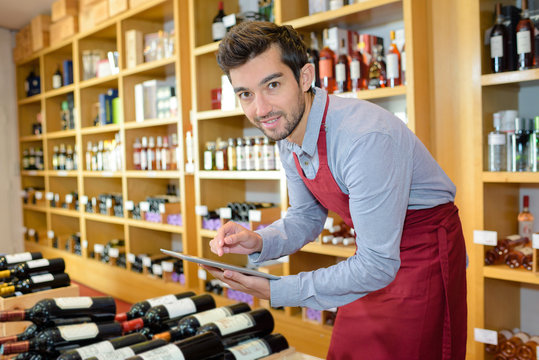 young man working in wine shop