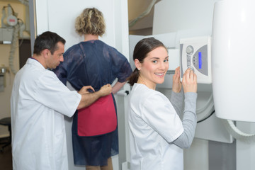 female patient having a hip examination through the xray
