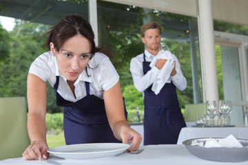 catering restaurant waitress setting table