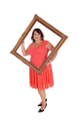 Big woman holding a picture frame