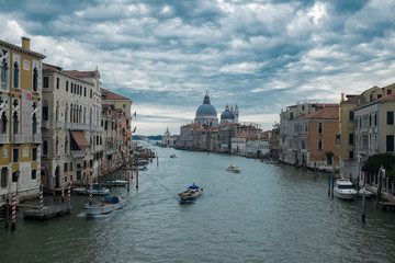 Canals of Venice, view of Santa Maria della Salute, Italy. Romantic travel photo background