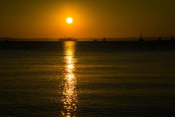 Gold sunset on Black Sea of Taman Gulf