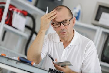mature man repairer solving problem