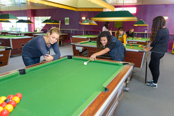 Ladies playing pool