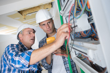 Trainee electrician learning to use multimeter