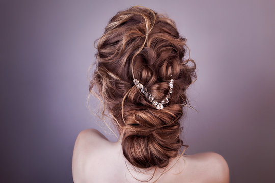 Model blonde Woman with perfect hairstyle and creative hair-dress, back view.