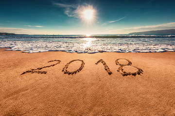 Happy New Year 2018 concept on the sea beach; sunrsie shot