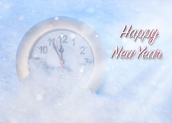 Watch in the snow. New Year's background.