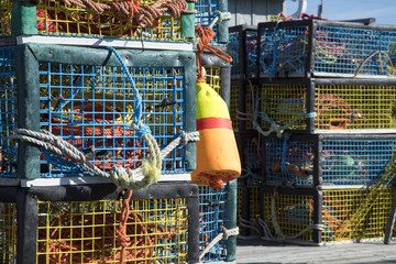 Colorful lobster traps on wooden pier