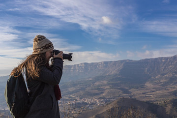 Woman photographing surreal landscape high in the mountains of Siurana, Spain