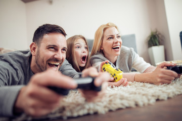 Happy family playing a video games at home