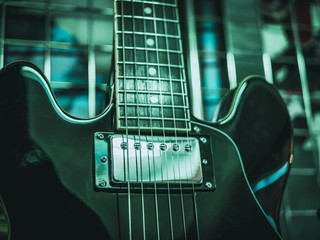 close up shot of electric guitar strings