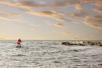 Santa on SUP board