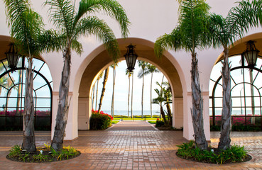 view of the Pacific ocean through a courtyard archway