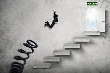 Male manager jumps toward success door