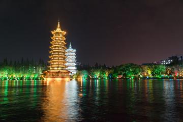 The Sun and Moon Pagoda at Night over the Lake Guilin China