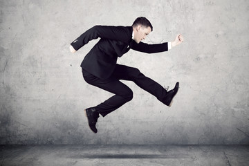 American businessman running with fast motion
